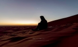 Photo taken in some place at the south of Taouz, Morocco, Algerian border. This is Hassan, a Berber dromedary rider. He's the one who guided me through the Sahara night. Once we were at the top of a dune, we just sat and waited the sun rising, enjoying every word of silence, under Moon and Venus and surrounded by an infinite sand sea.