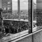 A man is looking the city from the Hall terrace.